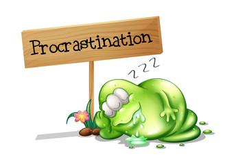 A green monster procrastinating beside a signboard