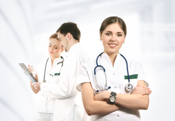 A team of young and smart medical workers in white clothes