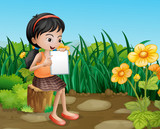 A girl studying at the garden