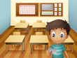 A young boy inside the classroom