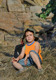 Educated little boy during a hiking expedition