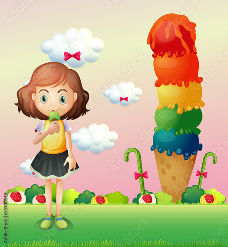 A girl eating an icecream beside a giant icecream