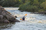 Man rafting with kayak on a fast watercourse