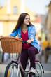 Urban biking - teenage girl and bike in city