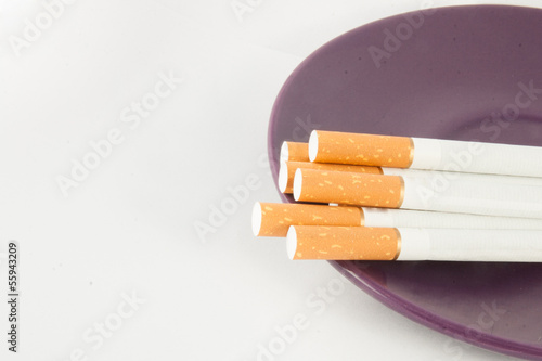 Several cigarettes on the plate