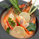 Tom yum goong spicy Thai seafood soup in bowl