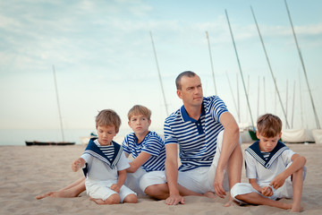 Portrait of happy family near yacht