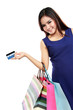 Beautiful woman holding shopping bags and credit card