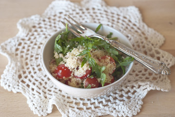 Couscous salad, tomatoes and rucola