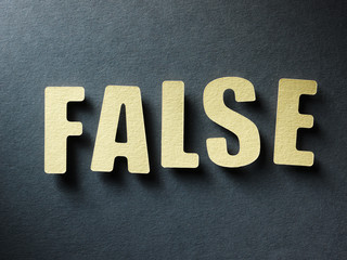 The word False on paper background