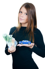 The beautiful woman with money and toy car