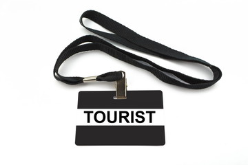 Tourist badge isolated on white background