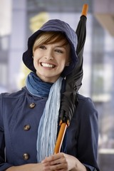 Happy young woman with umbrella