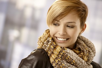 Portrait of young woman with scarf