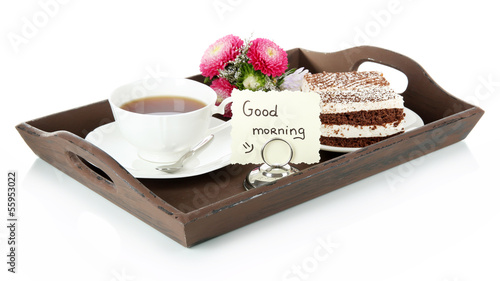 Cup of tea with cakes on wooden tray isolated on white