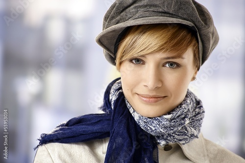 Attractive young woman in cap