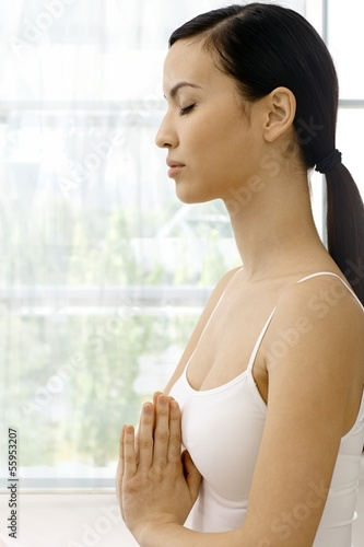 Profile of young relaxing woman