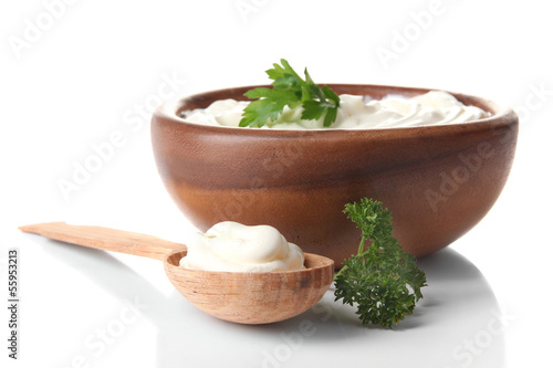 Sour cream in bowl isolated on white