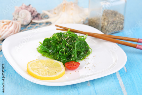 Sea kale on plate on wooden table close-up