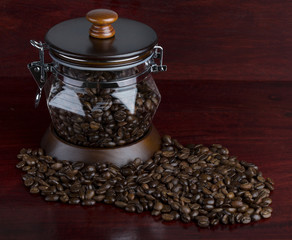 coffee beans scattered on a wooden surface
