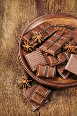 chocolate and star anise in a clay plate