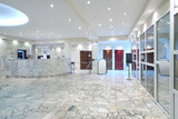 Reception area, glass entrance doors in office building