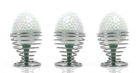 Golf Breakfast - Egg shaped golfballs in in egg cups on a white