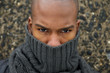 Fashion model with gray winter scarf covering face