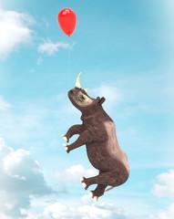 Rinoceronte  volando con globos