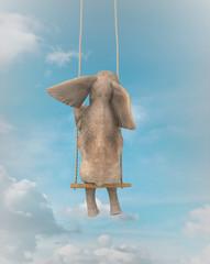 Elefante en un columpio