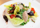 Creative salad with prunes and fish paste