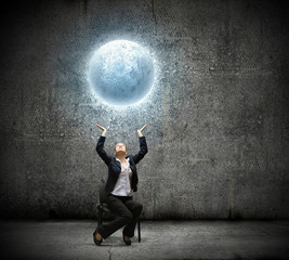 Businesswoman holding moon