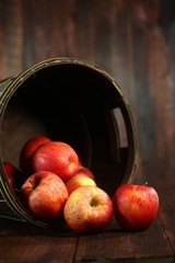 Barrel Full of Red Apples on Wood Grunge  Background