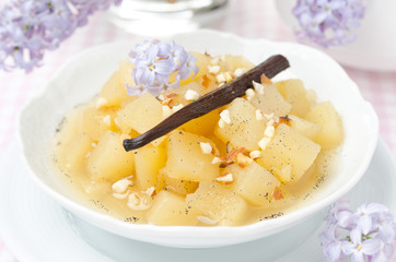 compote of apples and pears with vanilla in a bowl close-up