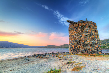 Ancient windmill ruin at sunset on Crete, Greece