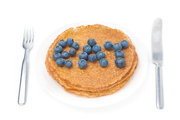 crepes and the words of fresh blueberries isolated on white