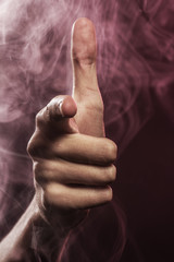 Index finger in a smoke