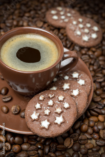 cup of coffee and Christmas cookies on coffee beans background