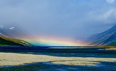 rainbow over the mountain lake