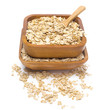 oat flakes in wooden bowls, isolated