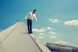 businessman standing on edge of the wing