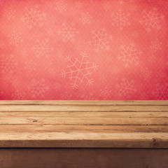 Christmas background with wooden table and snowflakes pattern