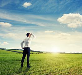 businessman on green field