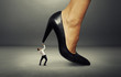 man under big female heel