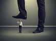 man with gun under big leg his boss