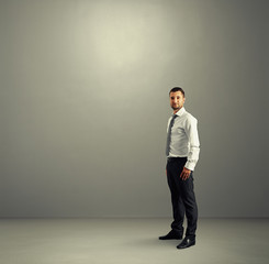 man standing in the grey room