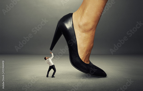 man under big female heel