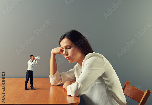 man urge on tired businesswoman
