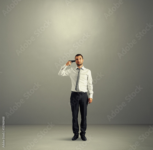 quiet businessman with gun in dark room