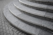 Leinwanddruck Bild - Curved modern gray stone stairs in the city